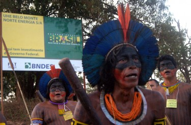 Indigenous protestors at the entrance of the construction site. © Ivan Canabrava/ Illuminati filmes shared by Movimento Xingu Vivo (used with permission).
