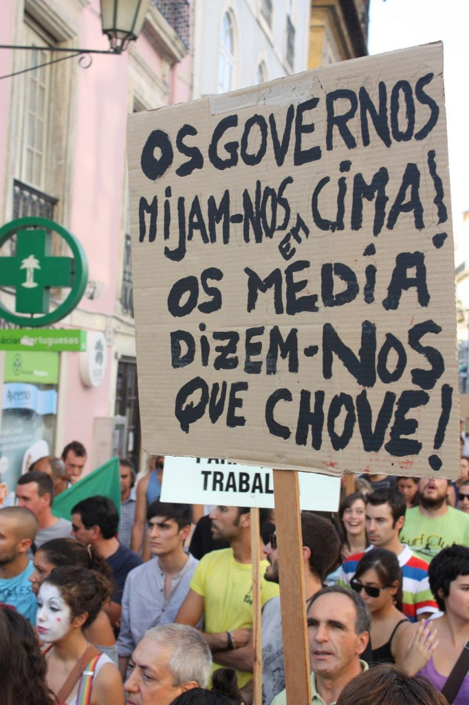 """The governments piss all over us! Media tells us it is raining!"" (Coimbra, 15/10/2011). Photo by Aurélio Malva shared on Facebook."