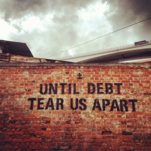 Until debt tear us apart. Urban art by maismenos.net in Lisbon. Photo by Miguel Manso (used with permission)