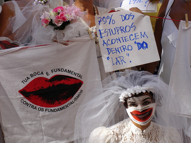 """Your mouth is the key to countering fundamentalism,"" ""70% of rapes occur inside the home."" Photo on Flickr by gaviota paseandera (CC BY-NC-ND). Porto Alegre, Brazil (2005)"
