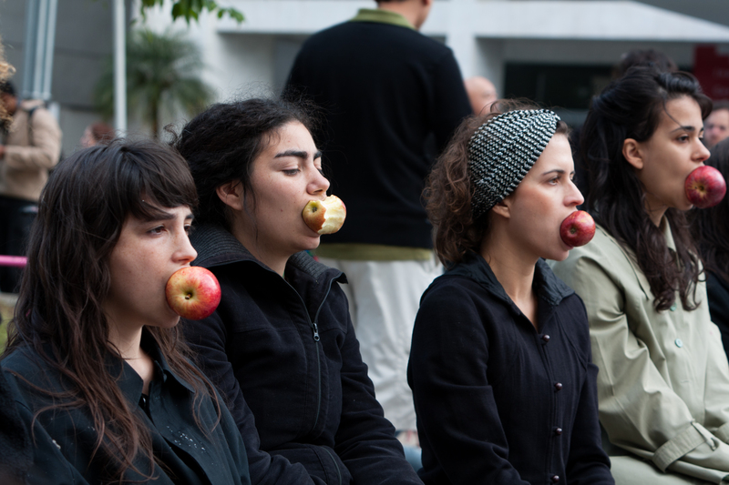 """Women biting apples, symbol of the forbidden fruit."" Photo by Andre M. Chang, copyright Demotix (04/06/2011), São Paulo, Brazil."