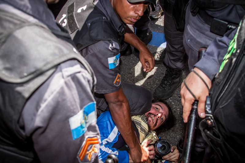 A photojournalist was arrested for being suspected of throwing a beer can at a police car during the Independance Day celebrations, on Avenida Presidente Vargas in Rio de Janeiro. Photo Marcio Isensee e Sá copyright Demotix (07/09/2013)