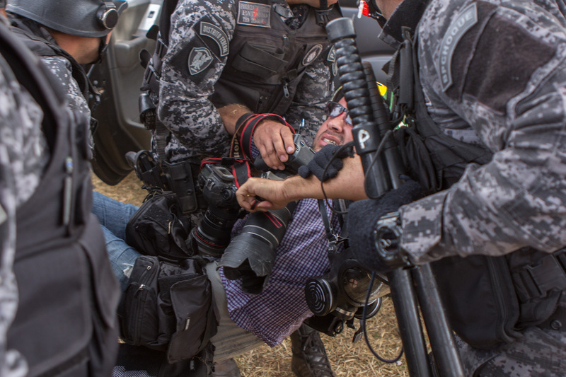 In the protests on Independence Day in Brasilia, a Reuters photojournalist states he has been attacked by a police dog and several other members of the press were also injured. Photo Osvaldo Ribeiro Filho copyright Demotix (07/09/2013)
