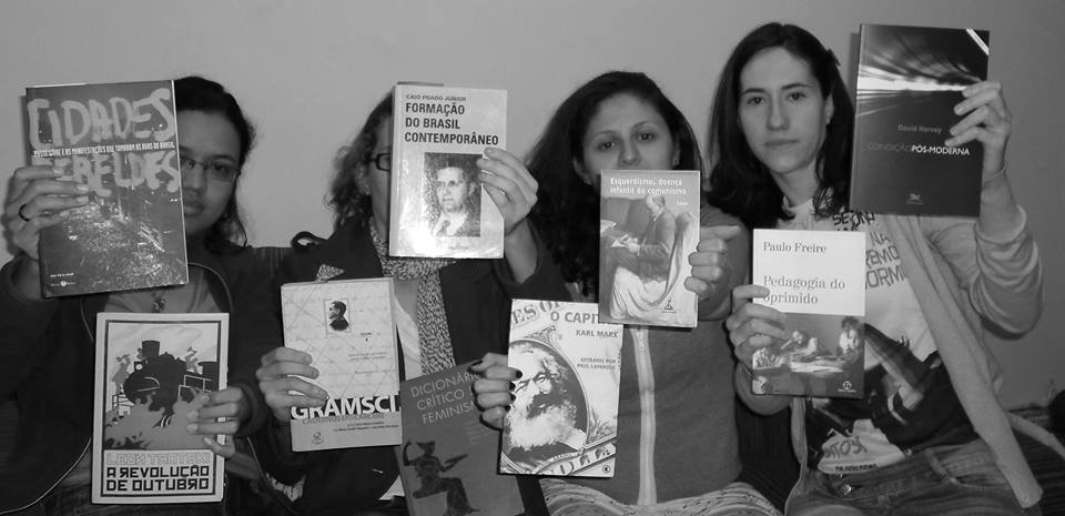 "Group of young women pose with some ""subversive"" literary works in protest against seizures at the house of protesters by the police."
