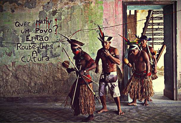 "Indians in one of the buildings of the complex. On the wall, it reads ""Do you want to kill a people? Then, rob them of their culture."". Photo: Facebook/Aldeia Maracanã"