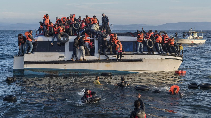 Syrian and Iraqi immigrants getting off a boat from Turkey on the Greek island of Lesbos.